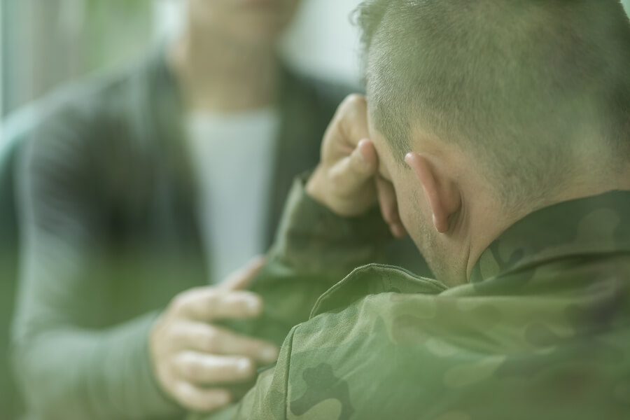 Therapist working with soldier in depression