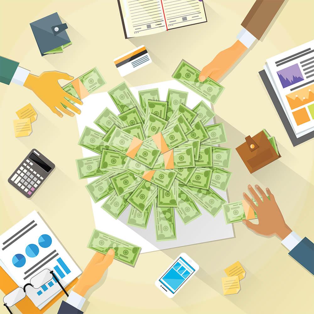 hands grabbing for money on a desk