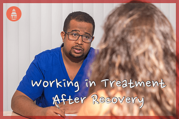Recovered addict doctor working with patient