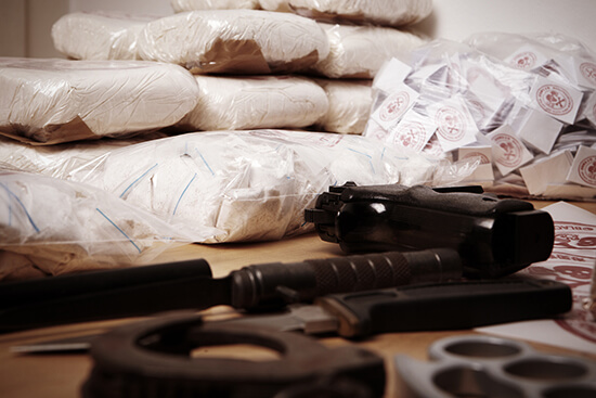 drugs seized by police with money and weapons