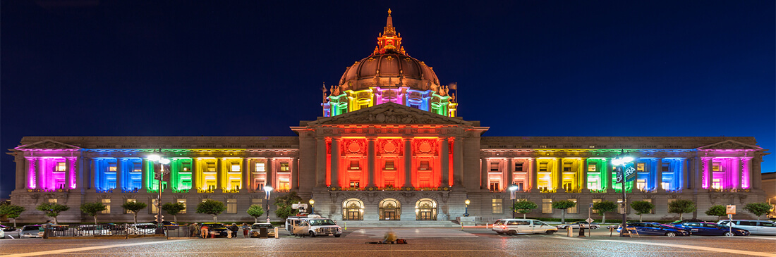 san francisco city hall lit up in LGBT support at night