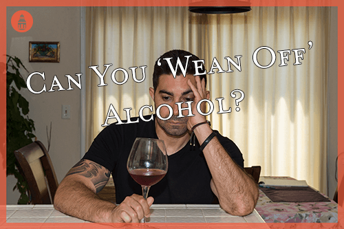 man staring at alcohol attempting to wean off