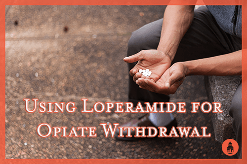 man holding loperamide pills while going through opiate withdrawal