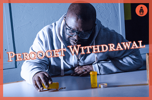man going through percocet withdrawal while staring at pills