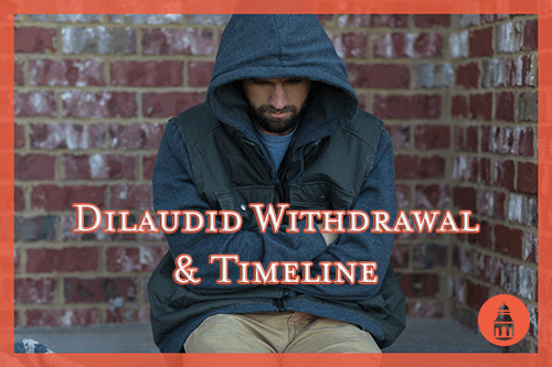 man sitting on bench while going through dilaudid withdrawal
