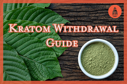 kratom in powder and pill form laying on wooden table
