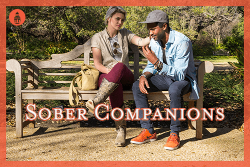 man being consulted by his female sober companion on a bench outside