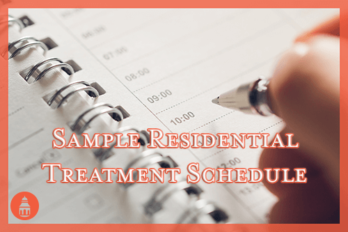 residential treatment schedule example with hand over paper