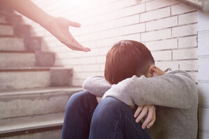 Giving person struggling with addiction helping hand